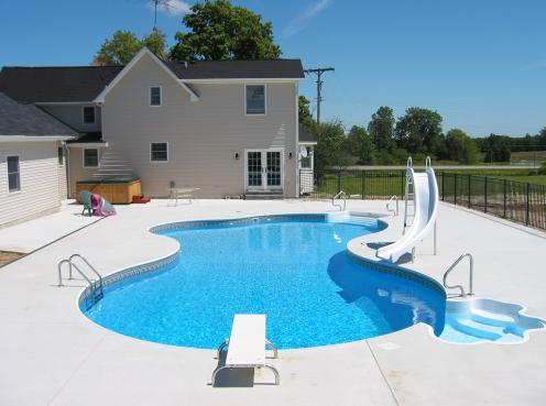 finished swimming pool in Lapeer, Mi free form vinyl liner pool shaped like a puddle oasis